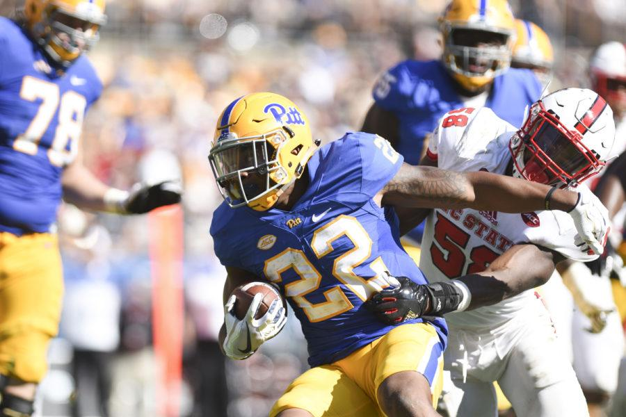 Pitt+running+back+Darrin+Hall+is+brought+down+by+NC+State+during+Pitt%27s+35-17+loss+Saturday.+%28Photo+by+Anna+Bongardino+%7C+Assistant+Visual+Editor%29