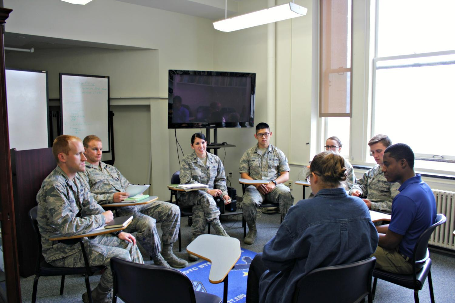 Pitt Air Force ROTC students talk with their commander,  Lt. Col. Diana Bishop, on the 29th floor of the Cathedral. (Courtesy of Jayson Baloy)