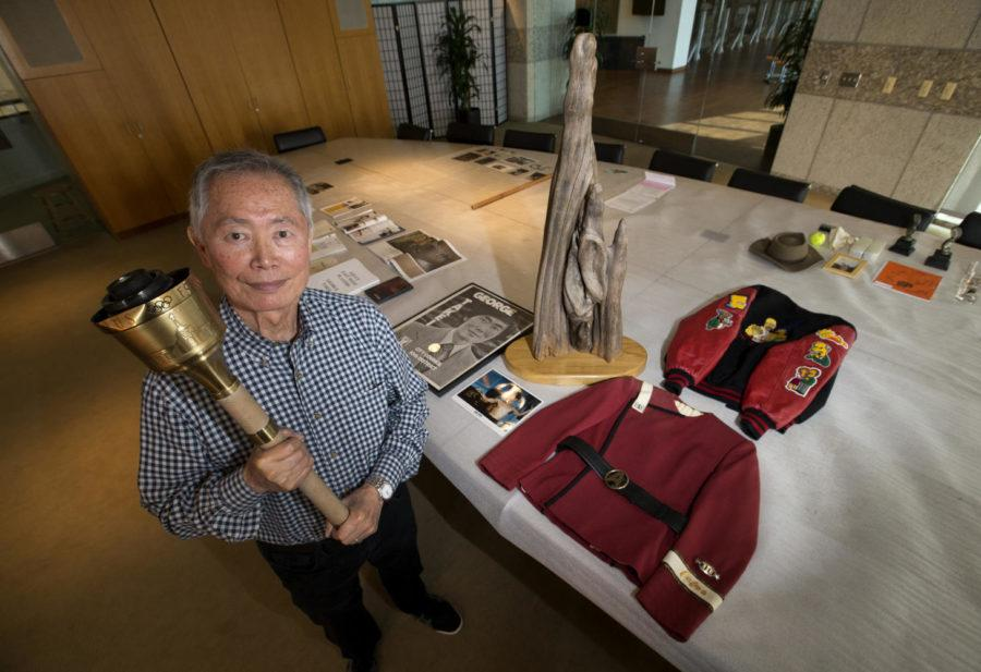 George Takei, photographed in 2016 holding the Olympic torch he carried in the 1984 Olympics, spoke at Soldiers and Sailors Tuesday. (Allen J. Schaben/Los Angeles Times/TNS)