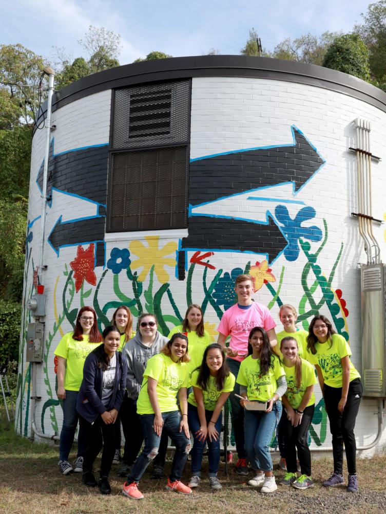 Students took a group picture after they painted a mural in Greenfield during PMADD 2017. (Photo courtesy of Student Affairs Marketing and Communication)