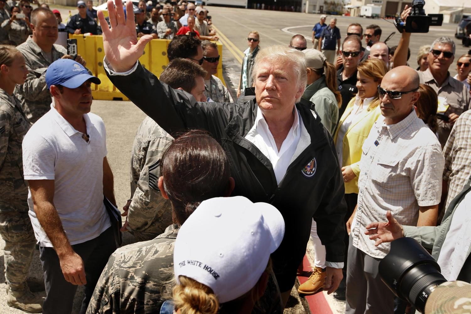 President Donald Trump and first lady Melania Trump arrive at Muniz Air National Guard Base in Carolina, Puerto Rico, on Oct. 3. (Carolyn Cole/Los Angeles Times/TNS)