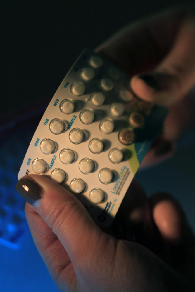 Some women are stocking up on birth control or switching to IUD's amid fears of birth control becoming more difficult to get. (Kirk McKoy/Los Angeles Times/TNS)