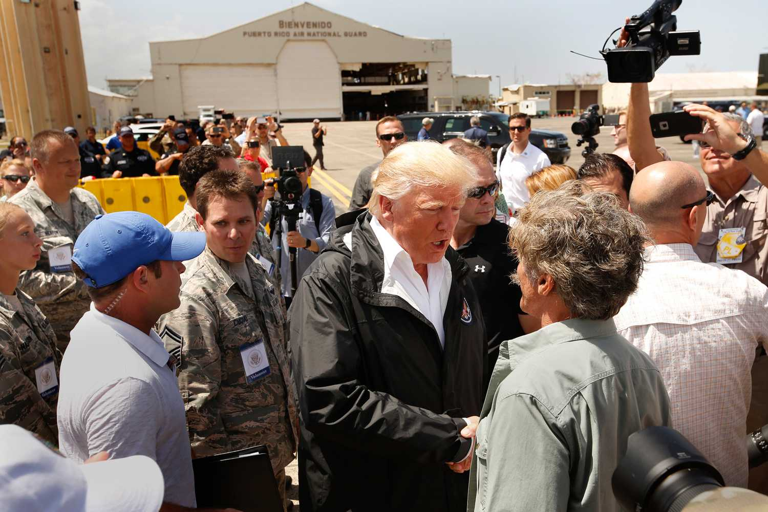 President Donald Trump and the First Lady Melania arrive at Muniz Air National Guard Base in Carolina, Puerto Rico on Oct. 3, 2017, almost two weeks after hurricane Maria hit the island. They met with residents there to greet the President. (Carolyn Cole/Los Angeles Times/TNS)