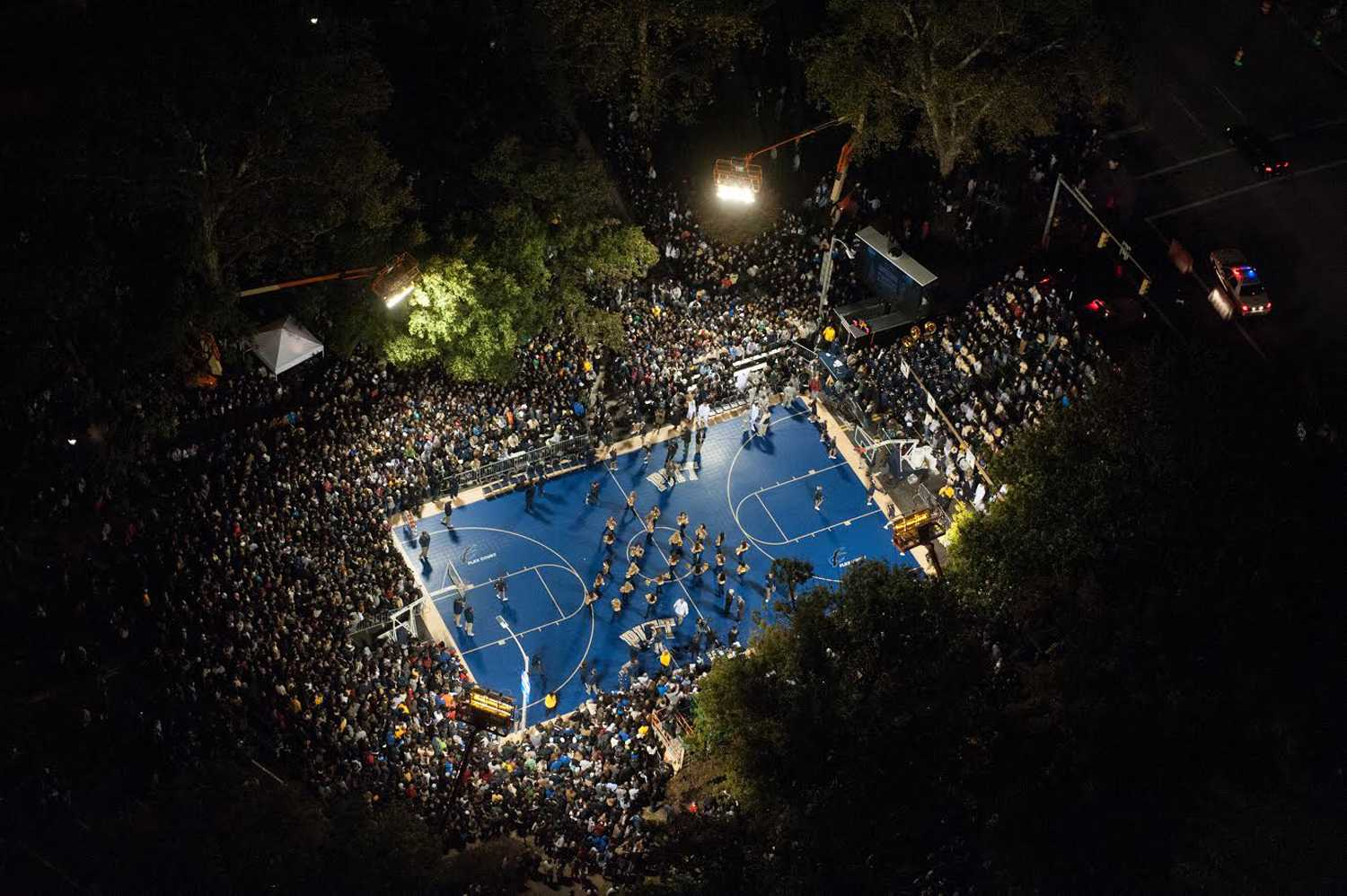 Students and fans gathered outside the Cathedral in 2012 to watch Pitt basketball take part in the night's events. (Courtesy of Pitt Athletics)