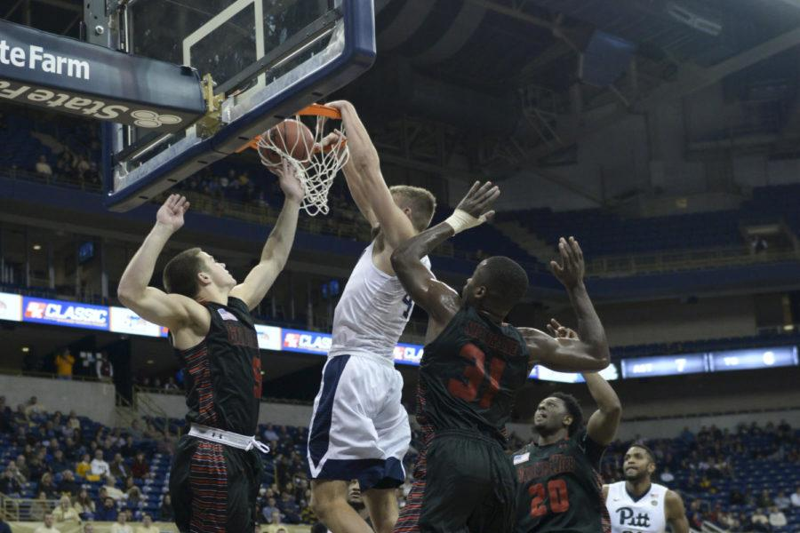 Ryan Luther dunked over two Gardner-Webb players last year, scoring eight points and three assists in 20 minutes. (Photo by Wenhao Wu | Assistant Visual Editor)