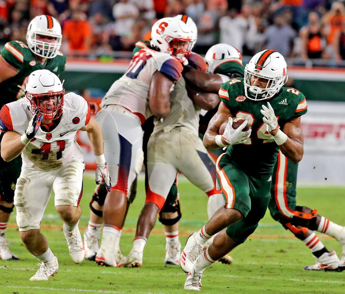 Miami running back Travis Homer (24) breaks away for a 33-yard fourth-quarter touchdown run against Syracuse Oct. 21. The Hurricanes won 27-19. (Charles Trainor Jr./Miami Herald/TNS)