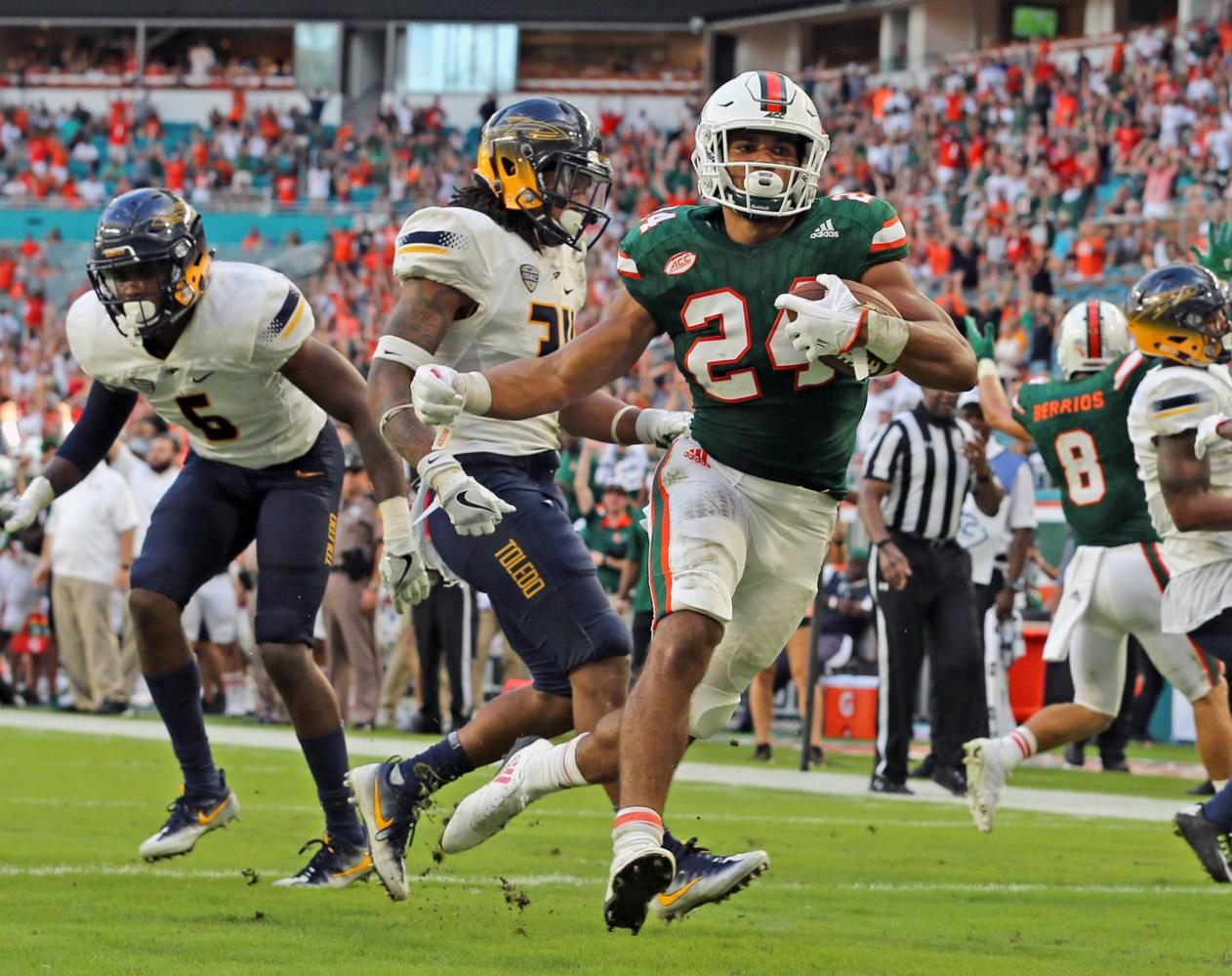 Miami Hurricanes' Travis Homer (24) runs for a third quarter touchdown against the Toledo Rockets on Saturday, Sept. 23, 2017 at Hard Rock Stadium in Miami Gardens, Fla. (Charles Trainor Jr./Miami Herald/TNS)