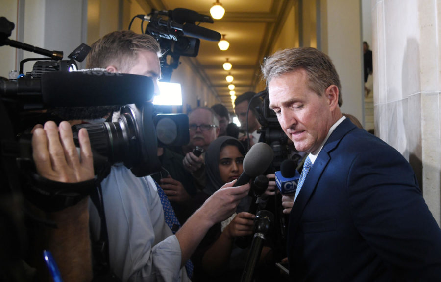 Republican+Sen.+Jeff+Flake+of+Arizona%2C+who+will+not+run+for+re-election%2C+answers+questions+from+reporters+on+Tuesday+on+Capitol+Hill.%0A+%28Douliery%2FAbaca+Press%2FTNS%29