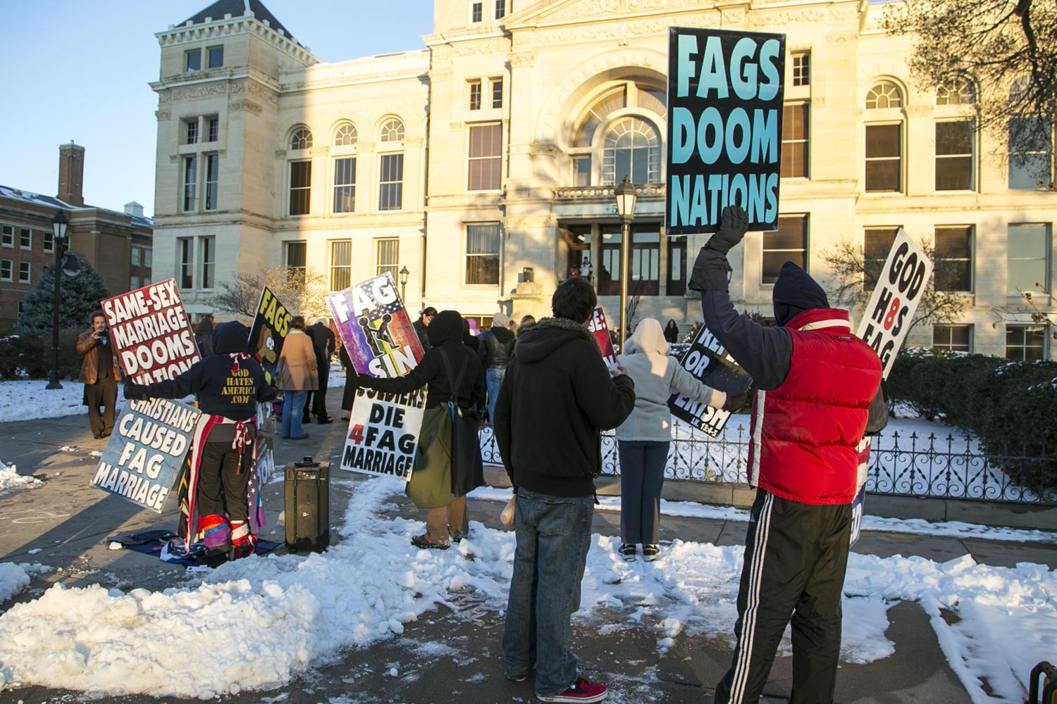 Protesters from Westboro Baptist Church picket a same-sex marriage ceremony in 2014 on the steps of the County Courthouse in Wichita, Kansas. (Mike Hutmacher/Wichita Eagle/TNS)