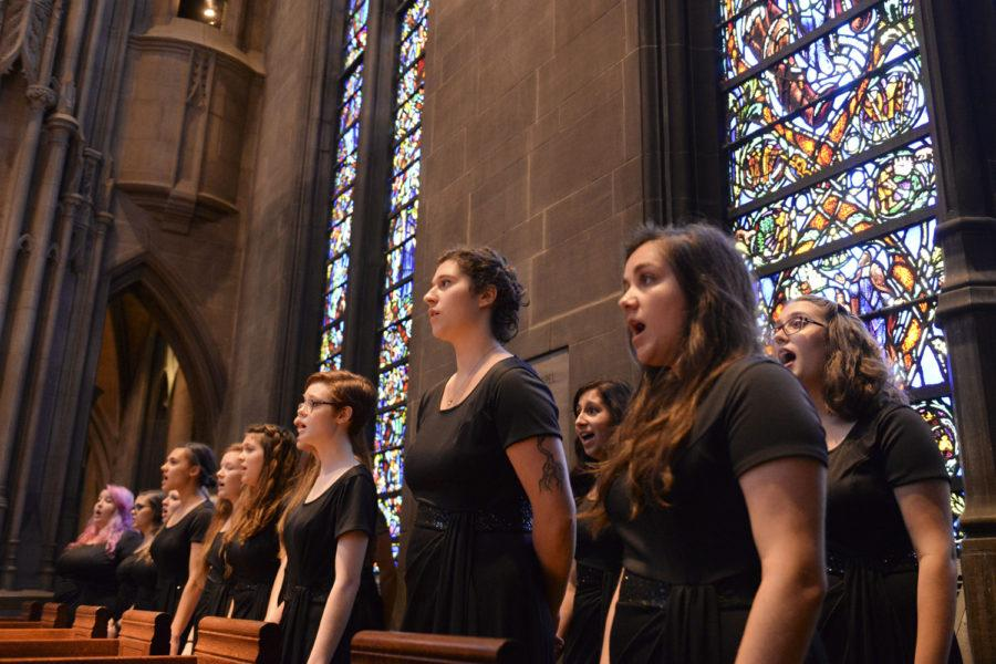 Pitt%E2%80%99s+Women%E2%80%99s+Choral+Ensemble+performed+its+90th+anniversary+fall+concert+in+Heinz+Chapel+Sunday.+%28Photo+by+Sarah+Cutshall+%7C+Staff+Photographer%29