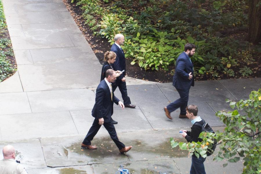Gov. Tom Wolf leaves the Cathedral of Learning after meeting with Chancellor Patrick Gallagher amid state funding concerns. (Photo by John Hamilton | Managing Editor)