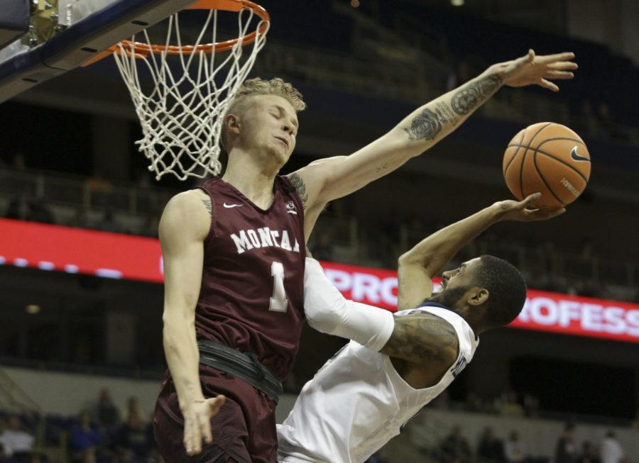 Redshirt senior guard Jonathan Milligan scored five points in the Panthers' loss to the Montana Grizzlies. (Photo by Thomas Yang | Senior Staff Photographer)
