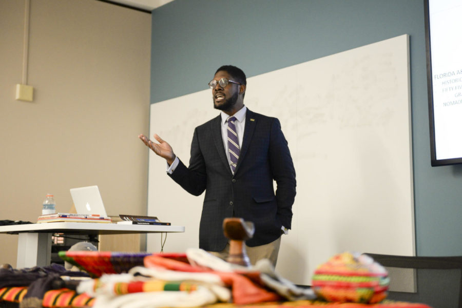 """Derric Heck, a graduate student at Pitt who studies social and comparative analysis in education, led a discussion titled, """"Identity, Culture & Education — Examples from Kenya and Ethiopia"""" Thursday afternoon. (Photo by Elise Lavallee 