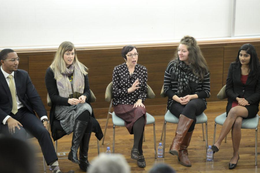 Adrienne Walnoha (center), CEO of Community Human Service, speaks at a panel discussion about homeless experiences of menstruation on Tuesday. (Photo by Aaron Schoen | Staff Photographer)