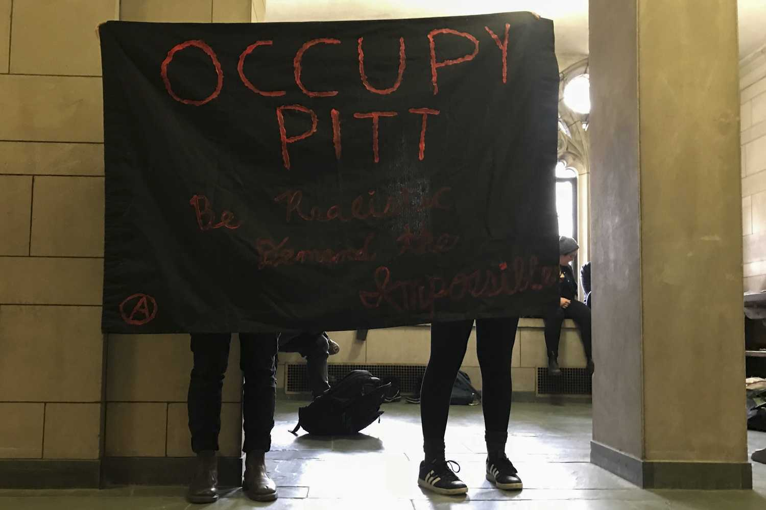 Student protesters occupied a small section of the Cathedral of Learning after delivering a letter to Chancellor Patrick Gallagher's office Tuesday. (Photo by Anna Bongardino | Assistant Visual Editor)
