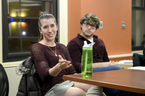 Bridget Duffy (left), a senior double major in English writing and Classics, talked about her affiliation with both the Catholic and Episcopal communities at Rainbow Alliance's Religious Panel Thursday evening. (Photo by Chiara Rigaud | Staff Photographer)