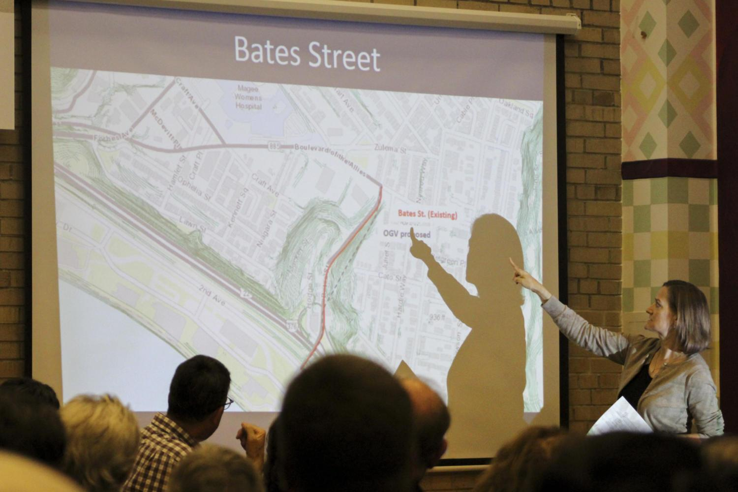 Wanda Wilson, executive director of OPDC, speaks against a proposed development along the Bates Street corridor during a town hall at the Oakland Career Center Thursday evening. (Photo by Hari Iyer | Staff Photographer)