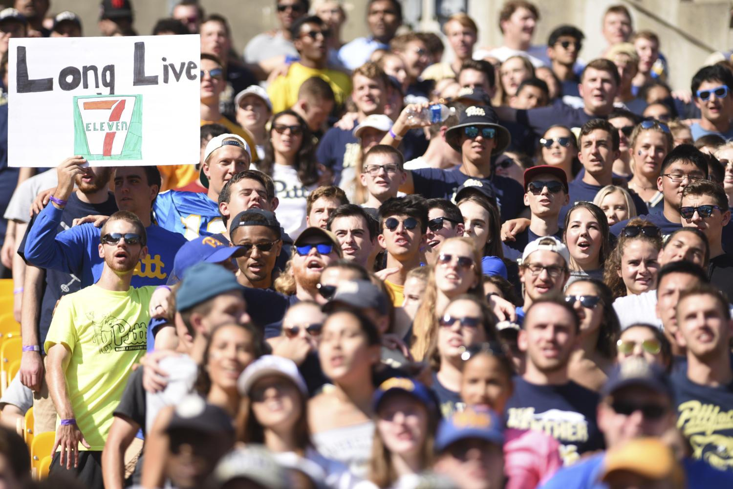 "First years Nolan Baker and Isaac Poole held a sign that read, ""Long Live 7-Eleven"" at Pitt's football game against NC State in October. (Photo by Anna Bongardino 
