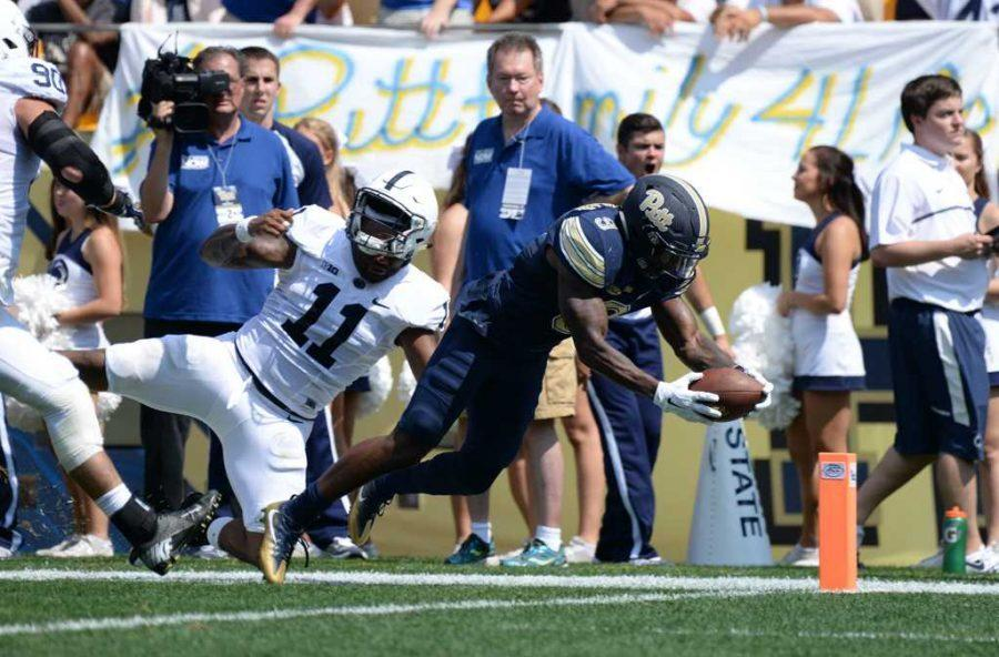 Jordan Whitehead dives for a touchdown during Pitt's win over Penn State in 2016. (TPN File Photo)