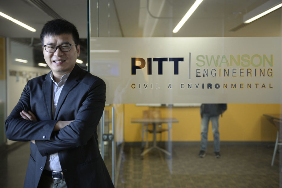 Hao+Sun%2C+an+assistant+professor+in+civil+and+environmental+engineering+at+Pitt+named+in+Forbes%E2%80%99+%E2%80%9C30+Under+30%3A+Science%E2%80%9D+list%2C+poses+for+a+photo+in+Benedum+Hall.+%28Photo+by+Elise+Lavallee+%7C+Contributing+Editor%29