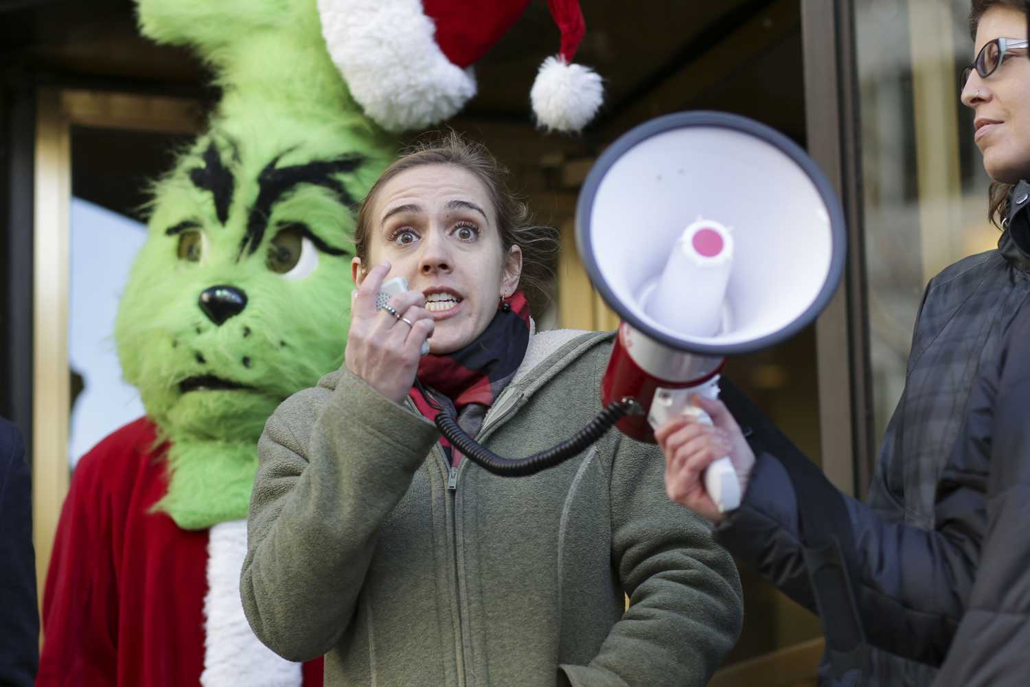Caitlin Schroering spoke at the protest outside of U.S. Sen. Pat Toomey's Downtown office Wednesday afternoon. (Photo by Thomas Yang | Senior Staff Photographer)