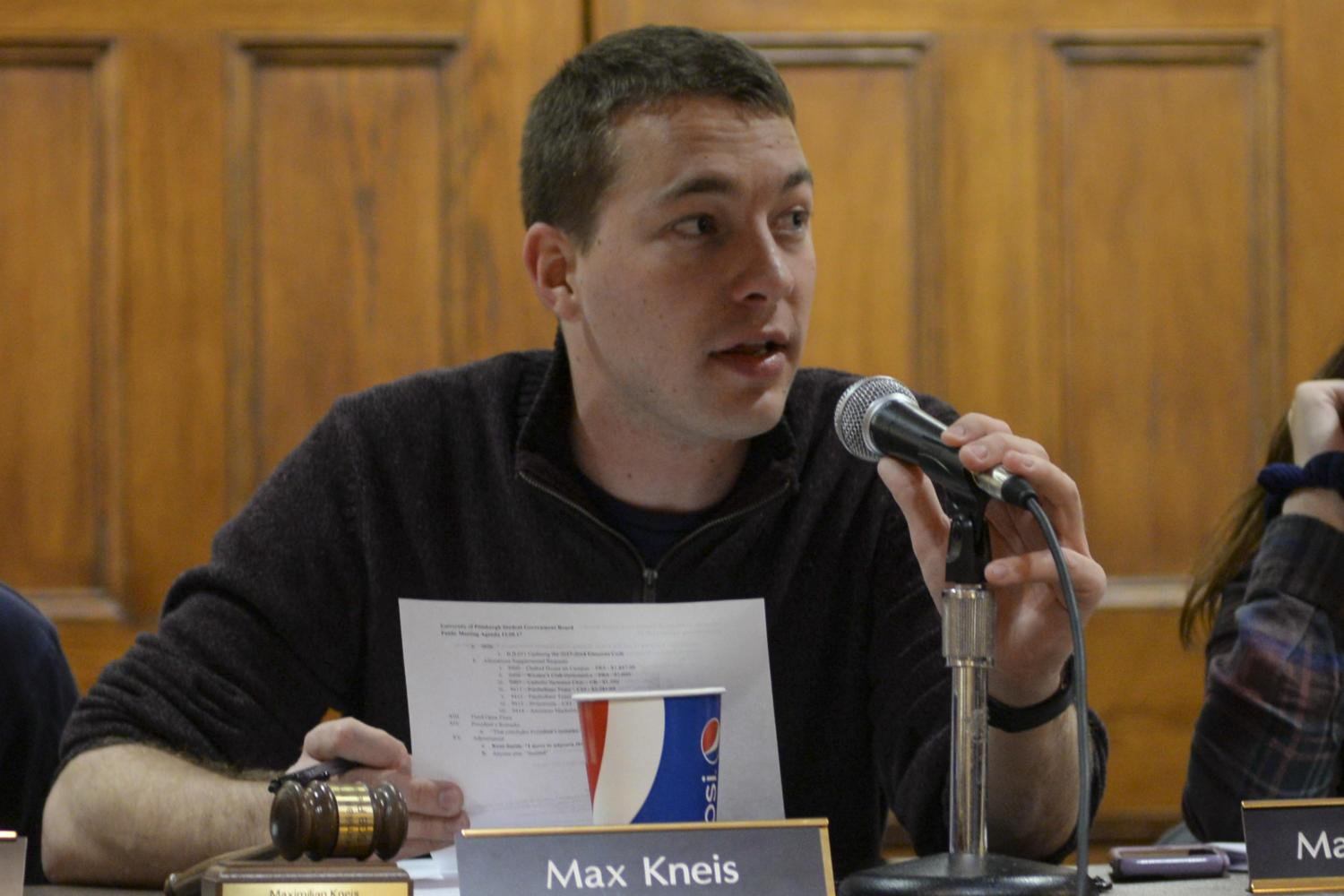SGB President Max Kneis discusses the possibility of improving Pitt's student union and reminds students to fill out Princeton Review and OMET surveys during Tuesday's meeting. (Photo by Sarah Cutshall | Staff Photographer)
