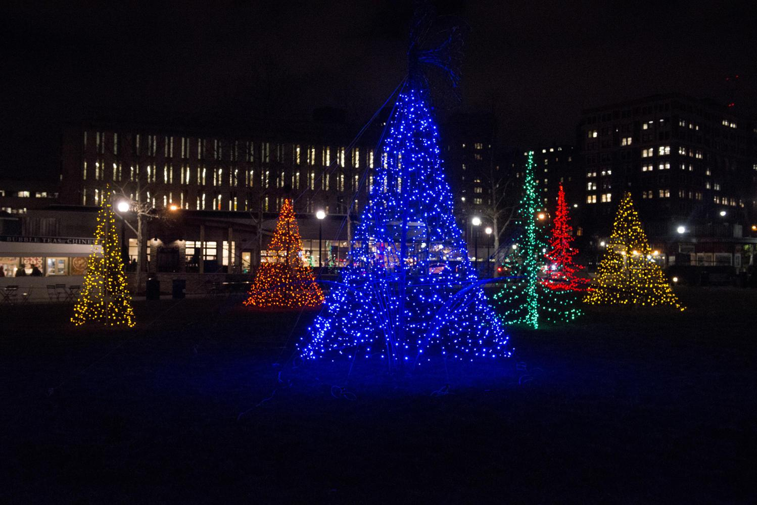 Christmas trees in Schenley Plaza are lit up at night during the holiday season. (Photo by Elise Lavallee | Contributing Editor)