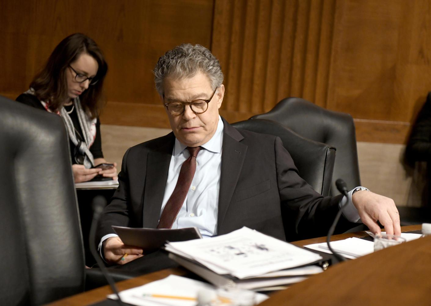 U.S. Sen. Al Franken, D-Minn., looks over his notes prior to hearing Alex M. Azar II testify before the Senate Committee on Health, Education, Labor and Pensions on his nomination to be Secretary of Health and Human Services Wednesday, Nov. 29, 2017 on Capitol Hill in Washington, D.C. A series of Senate Democratic women issued calls for Franken to resign Wednesday morning. (Ron Sachs/CNP/Zuma Press/TNS)