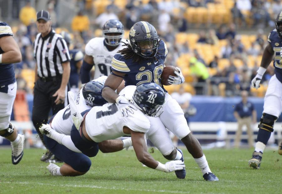 Running back Chawntez Moss rushes against Rice in September. Moss will not return to the Panthers football team next year. (Photo by Thomas Yang / Senior Staff Photographer)