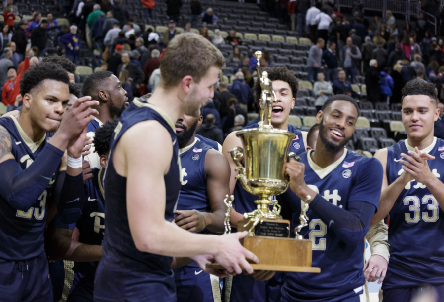 The Panthers celebrate after winning the City Game against the Duquesne Dukes 76-64. (Photo by Thomas Yang / Senior Staff Photographer)
