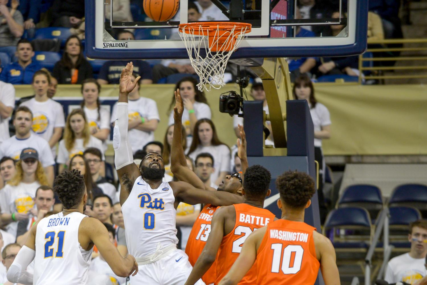 Senior Guard Jared Wilson-Frame (0) attempts a layup during Pitt's 60-55 loss to Syracuse. (Photo by Chiara Rigaud | Staff Photographer)