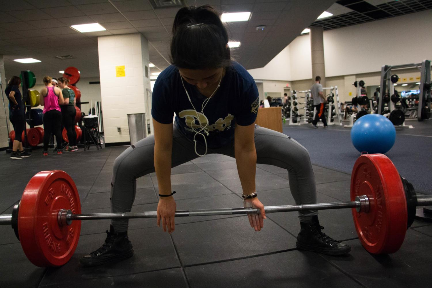 Rui Tanimura, a senior nutrition major and founding member of Pitt's club powerlifting team, trains for the deadlift. (Photo by Christian Snyder | Multimedia Editor)