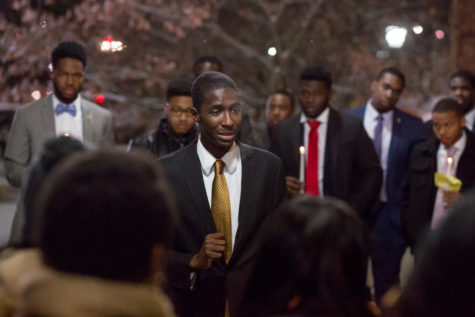 Junior communication and political science major Aaron Hill speaks in front of participants at Alpha Phi Alpha's Martin Luther King Jr. Day candlelight vigil Monday night. (Photo by Thomas Yang | Visual Editor)