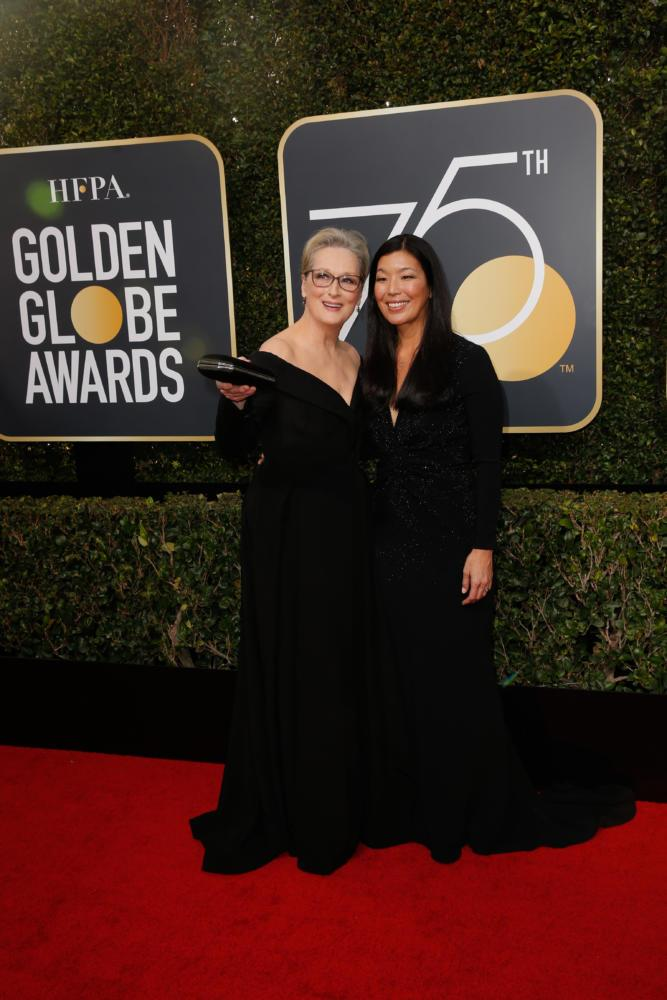 Meryl Streep and Ai-jen Poo arrive at the 75th Annual Golden Globes at the Beverly Hilton Hotel in Beverly Hills, Calif., on Sunday, Jan. 7, 2018. (Jay L. Clendenin/Los Angeles Times/TNS)