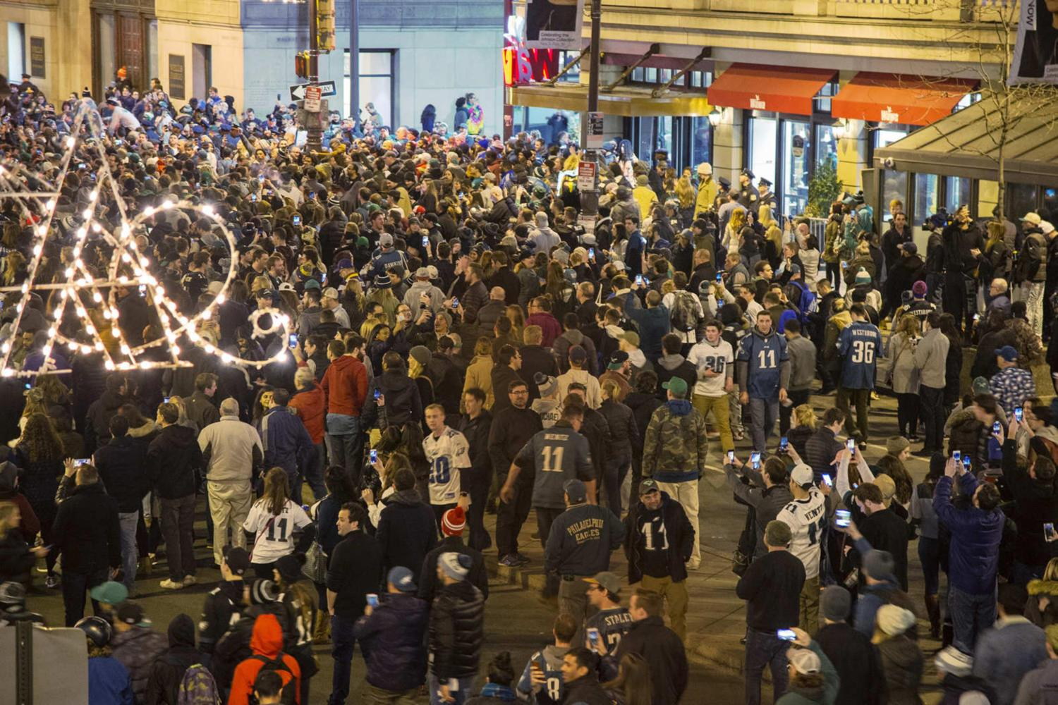 Crowds of Philadelphia Eagles fans celebrate at Broad and Walnut streets after the Eagles won the NFC Championship game over the Minnesota Vikings on Sunday. (Tom Gralish/Philadelphia Inquirer/TNS)