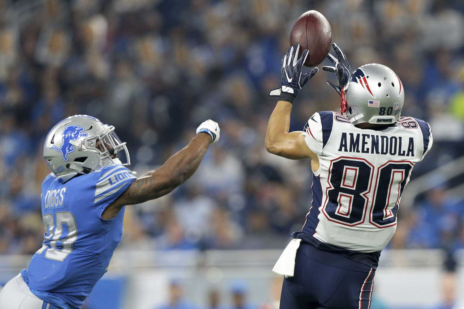 New England Patriots wide receiver Danny Amendola (80) goes up for a catch guarded by Detroit Lions cornerback Quandre Diggs (28) during the first half of a pre season NFL football game on Aug, 25, 2017 in Detroit, Mich. (Jorge Lemus/NurPhoto/Sipa USA/TNS)