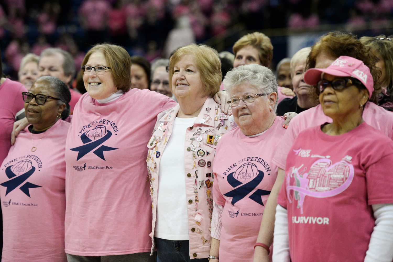 Breast cancer survivors stand together at 2017's Pink the Pete game. (Photo by Anna Bongardino | Senior Staff Photographer)
