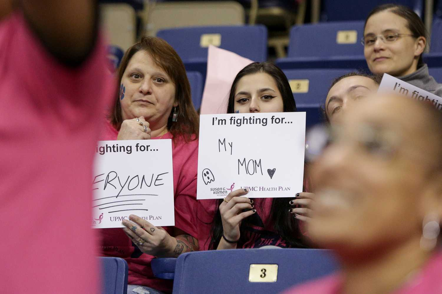 Attendees of Sunday's Pink the Pete game held signs in support of those affected by breast cancer. (Photo by Thomas Yang | Visual Editor)