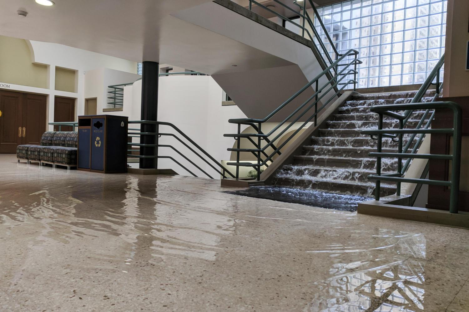 Water floods down the stairs in the William Pitt Union Sunday morning. (Photo by John Hamilton / Managing Editor)