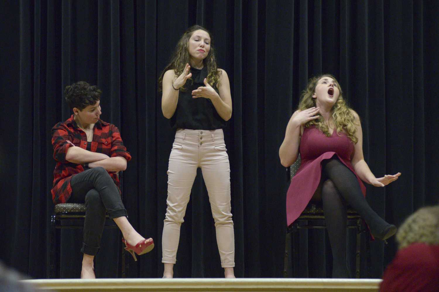 Natalie Miller (left), Emily Rush, and Savannah Garber (right) perform as part of the Vagina Monologues hosted by the Pitt Campus Women's Organization in the O'Hara Student Center this weekend. (Photo by Issi Glatts | Assistant Visual Editor)