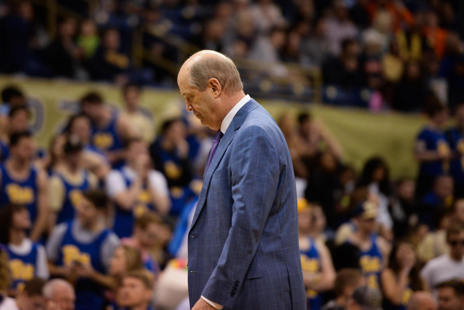 Head coach Kevin Stallings walks off the court after Pitt scored seven points in the first half against Virginia on Feb. 24. (Photo by John Hamilton / Managing Editor)