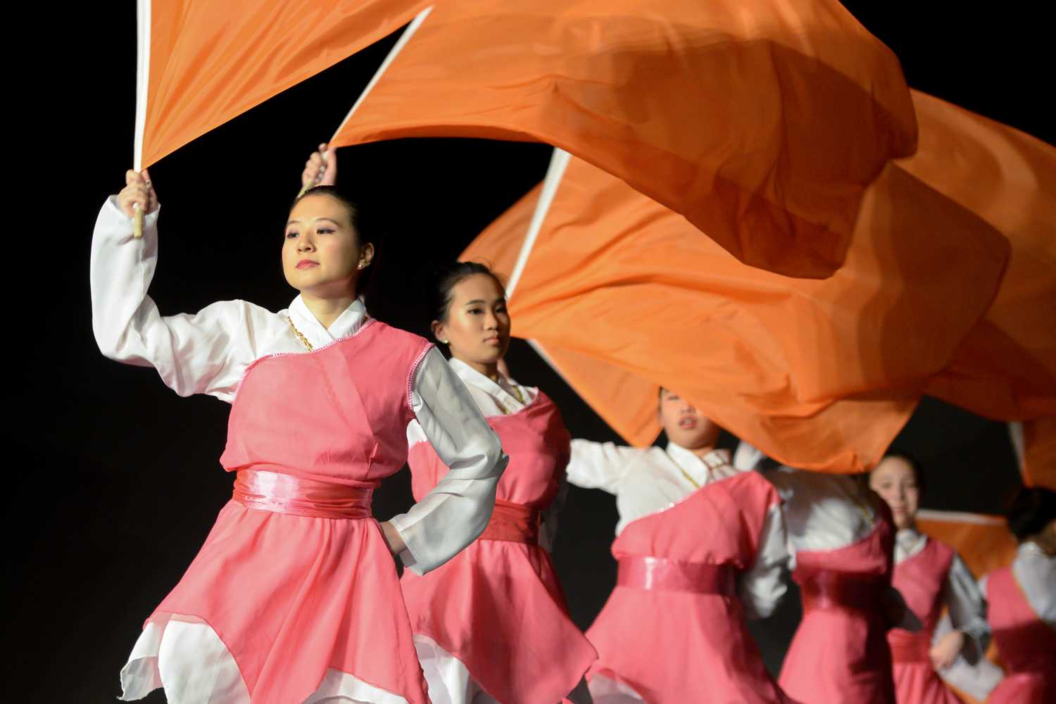 Members of the Organization of Chinese Americans perform a flag dance during Sunday's Lunar New Year event. (Photo by Thomas J. Yang | Visual Editor)