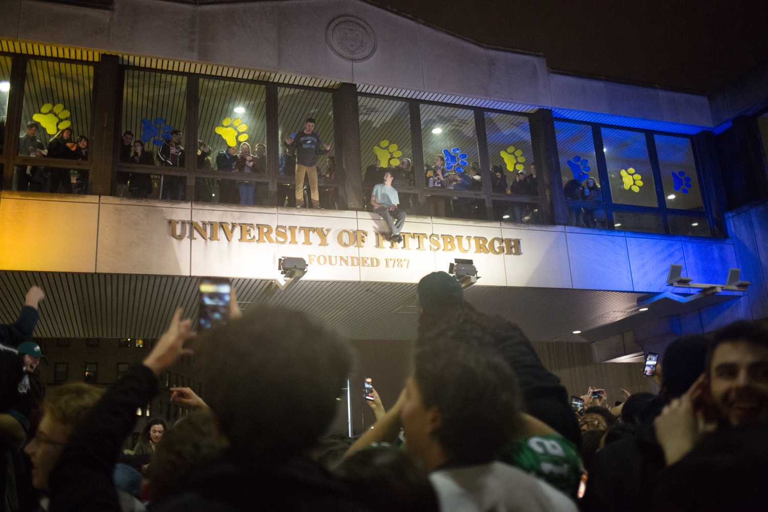 Students climb on the skybridge over Forbes Avenue after the Eagles' Super Bowl win. (Photo by Thomas Yang / Visual Editor)