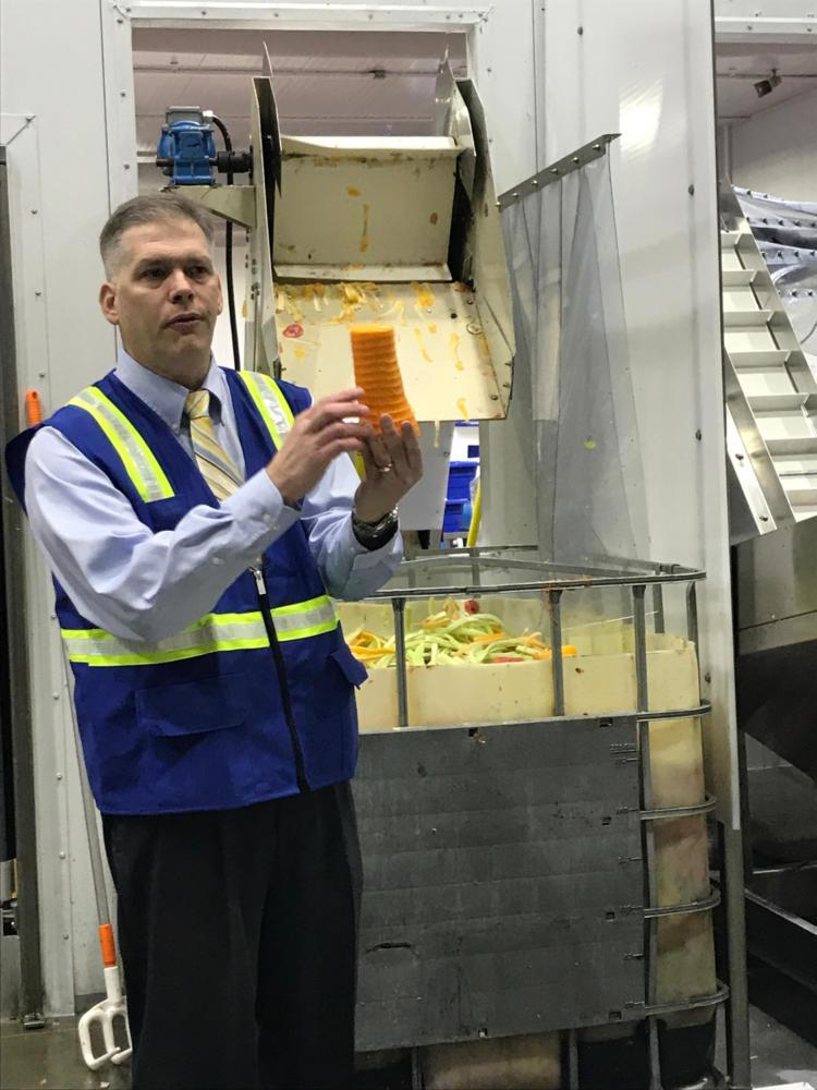 Paragon Director of Sales Anthony Tomasic holds a peeled butternut squash during a tour of the Warrandale facility Friday. (Photo by Janine Faust | Contributing Editor)