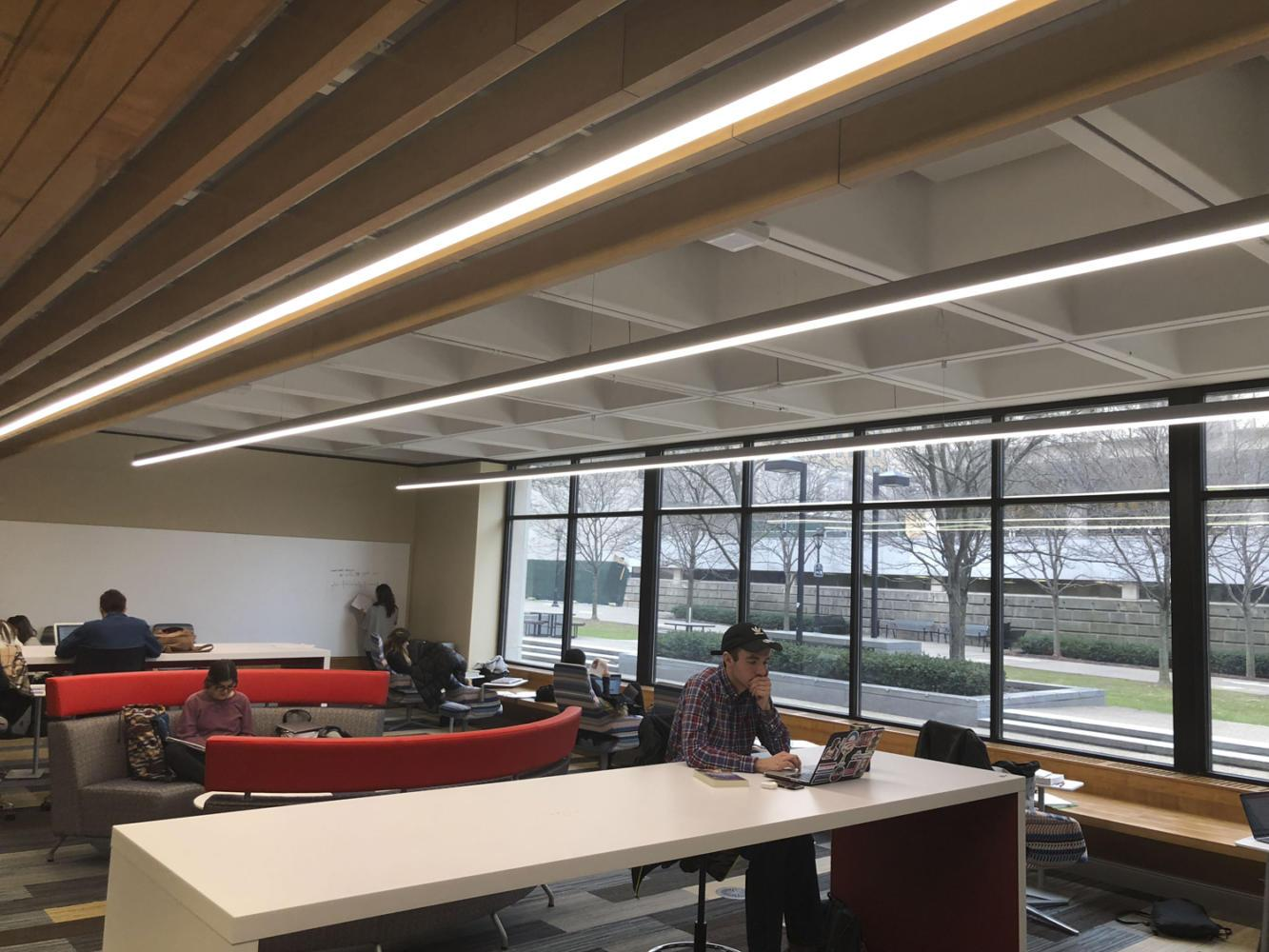 Students study in one of the newly renovated rooms in Posvar Hall, designed to be a study space. (Photo by Thompson Wymard | Contributing Writer)