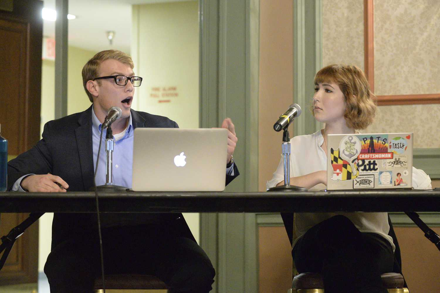 Kyle Guinness and Katherine Ranck, members of Pitt Libertarians, debate wealth redistribution Wednesday night in the William Pitt Union. (Photo by Issi Glatts | Assistant Visual Editor)