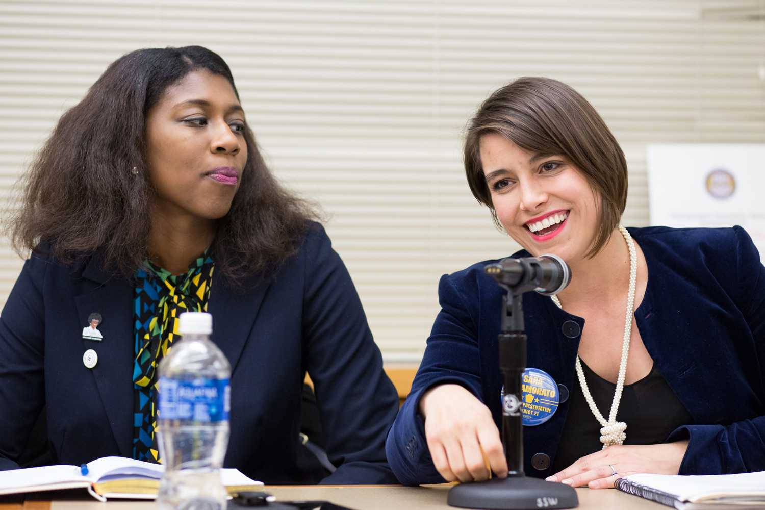 Mayor of Wilkinsburg Marita Garrett (left) listens as District 21 State Representative candidate Sara Innamorato discusses her entry into the political field at Sunday evening's Women in Politics panel. (Photo by Thomas Yang | Visual Editor)