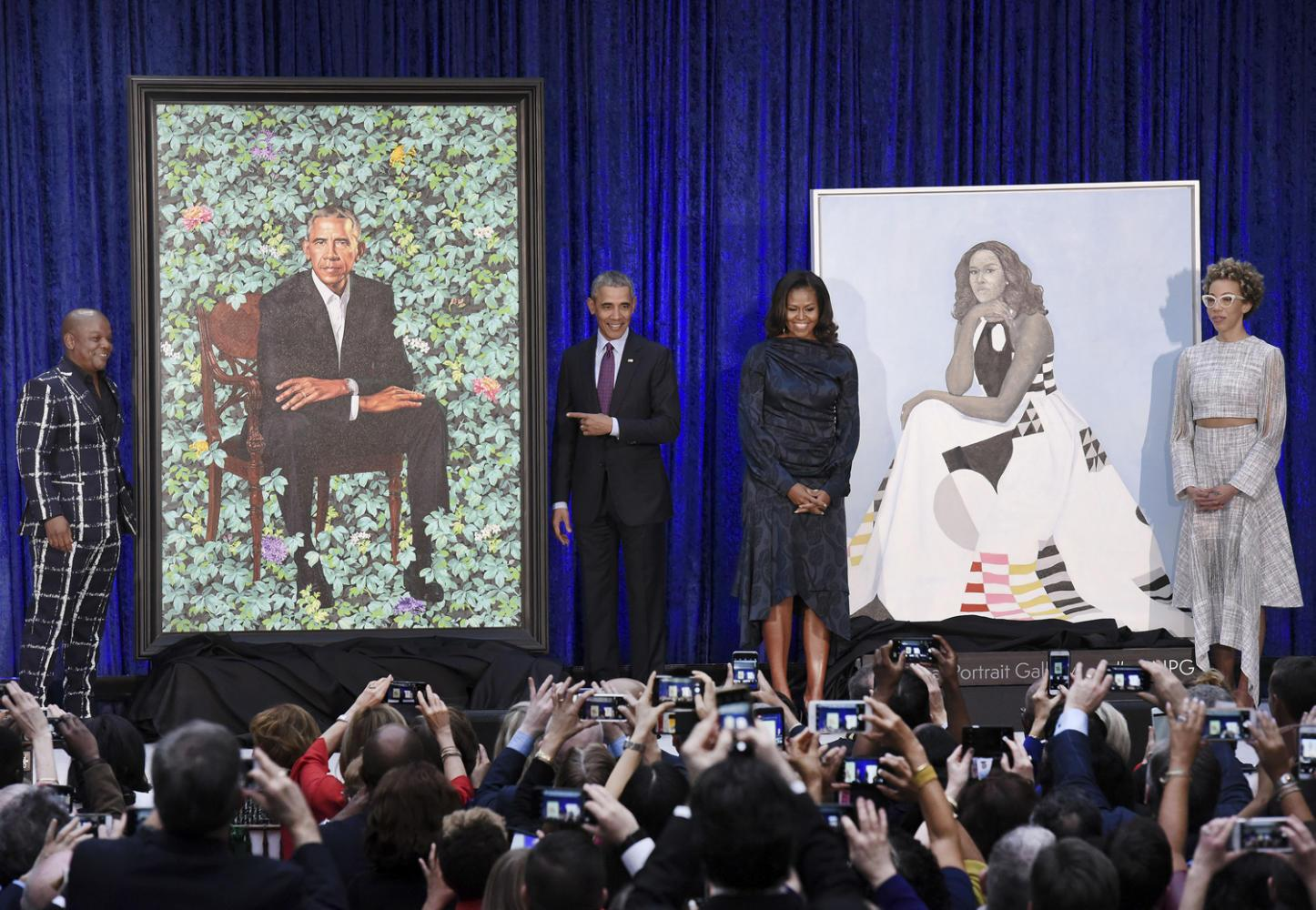 Former First Lady Michelle Obama and former President Barack Obama pose with artists Kehinde Wiley and Amy Sherald during the unveiling of their official portraits at the National Portrait Gallery Monday in Washington, D.C. (Olivier Douliery/Abaca Press/TNS)