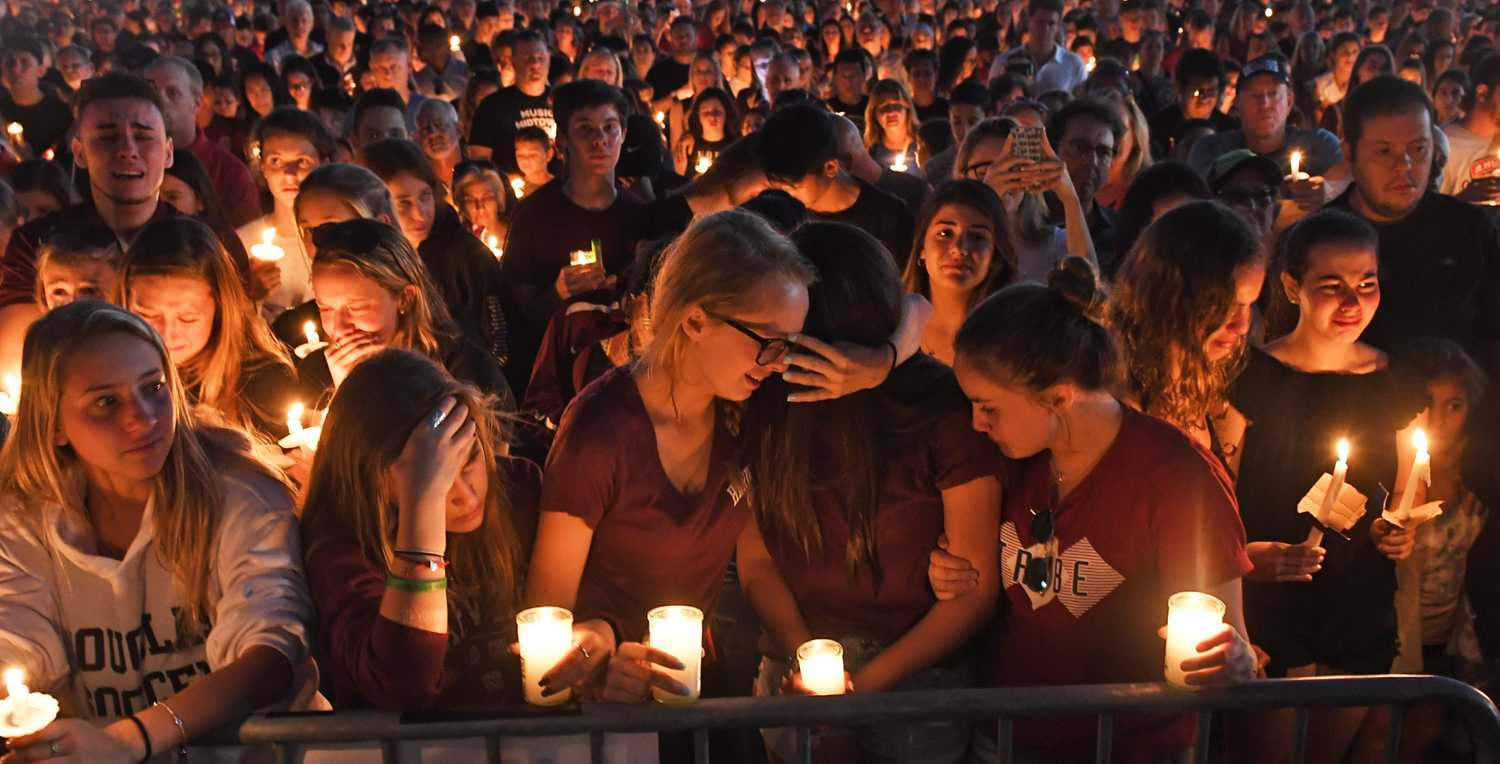 Mourners gather at a vigil that was held for the victims of the mass shooting at Marjory Stoneman Douglas High School in Parkland, Florida, on Thursday. (Jim Rassol/Sun Sentinel/TNS)