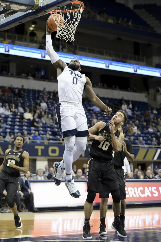 Jared Wilson-Frame (0), junior guard and forward, missed a dunk with 10 seconds left in Pitt's loss to Wake Forest Wednesday night. (Photo by Thomas Yang | Visual Editor)